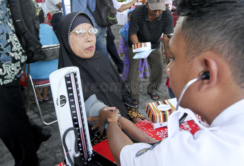 Medical treatment. Old women were getting medical treatment at a village in Sukoharjo, Central Java, Indonesia royalty free stock images