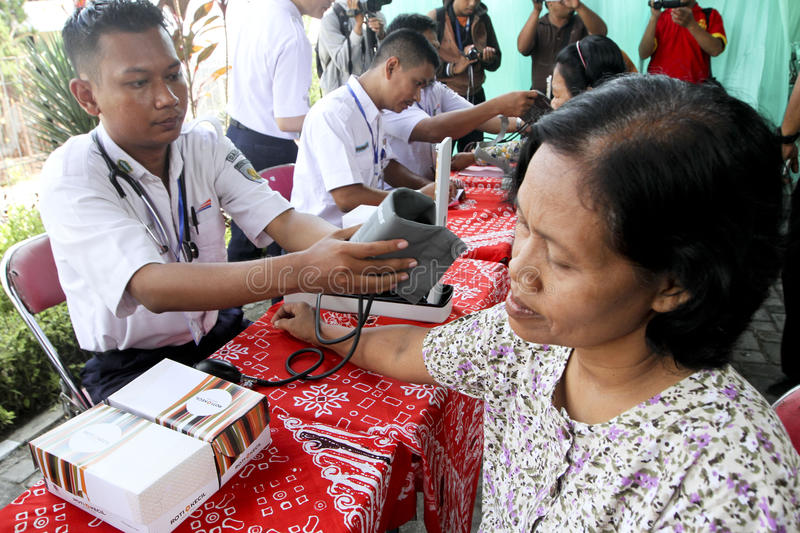 Medical treatment. Old women were getting medical treatment at a village in Sukoharjo, Central Java, Indonesia royalty free stock photo