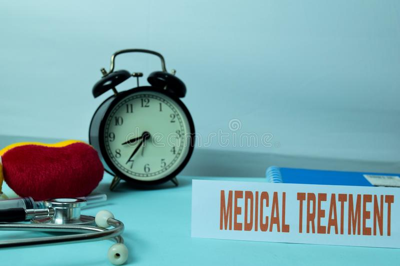 Medical Treatment Planning on Background of Working Table with Office Supplies. royalty free stock photos