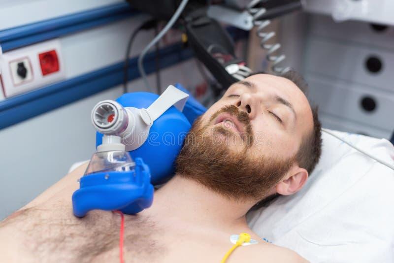 Medical urgency in the ambulance. Cardiopulmonary resuscitation using hand valve mask bag stock image