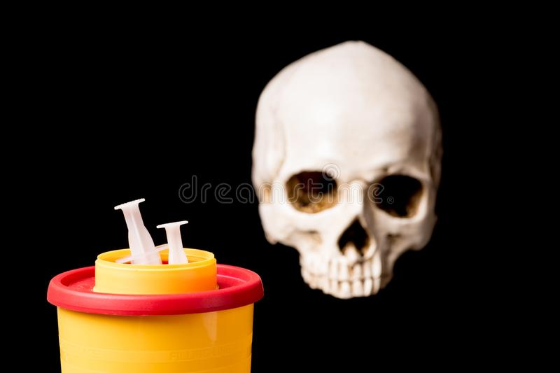 Medical waste container and skull royalty free stock images