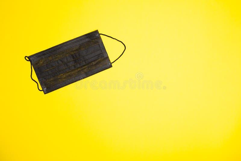 Medical wearable black sterile face mask modern stock photography
