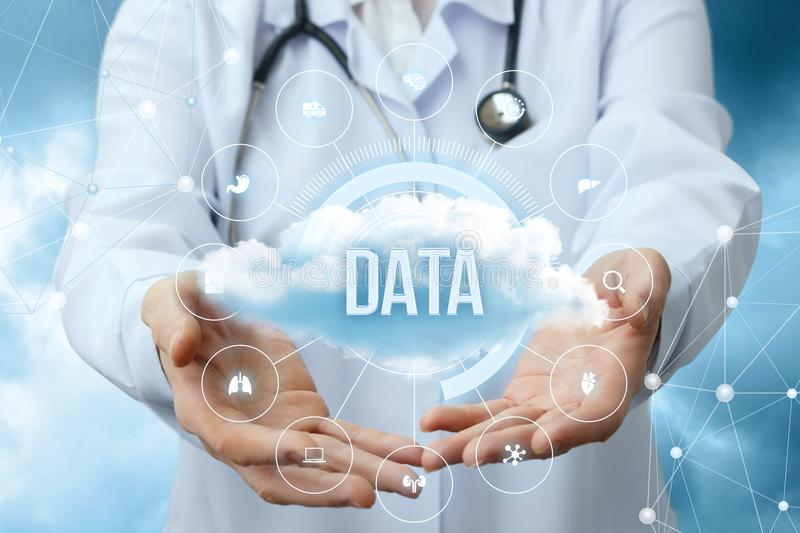 Medical worker shows the data cloud. stock photos