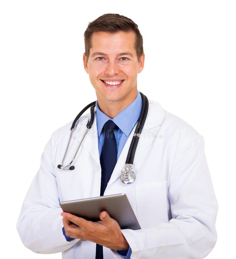 Medical worker tablet computer. Handsome medical worker holding tablet computer on white background stock image