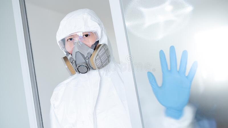 Medical worker wearing biohazard protective suit royalty free stock photos