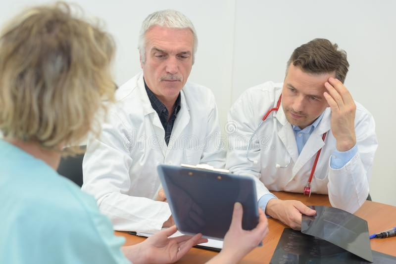 Medical workers comparing notes royalty free stock images