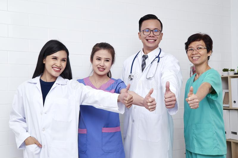 Medical workers on wall background royalty free stock images