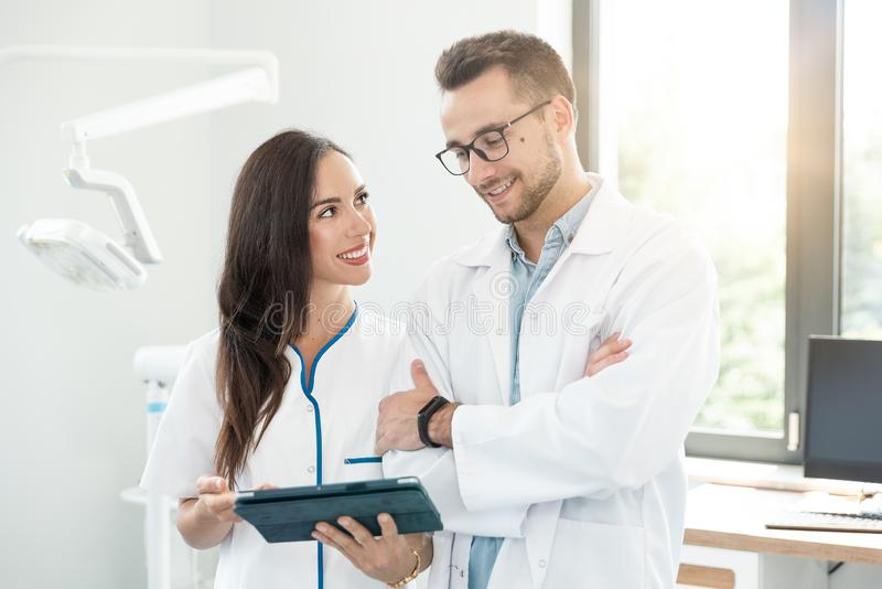 Medical workers working together in office stock image