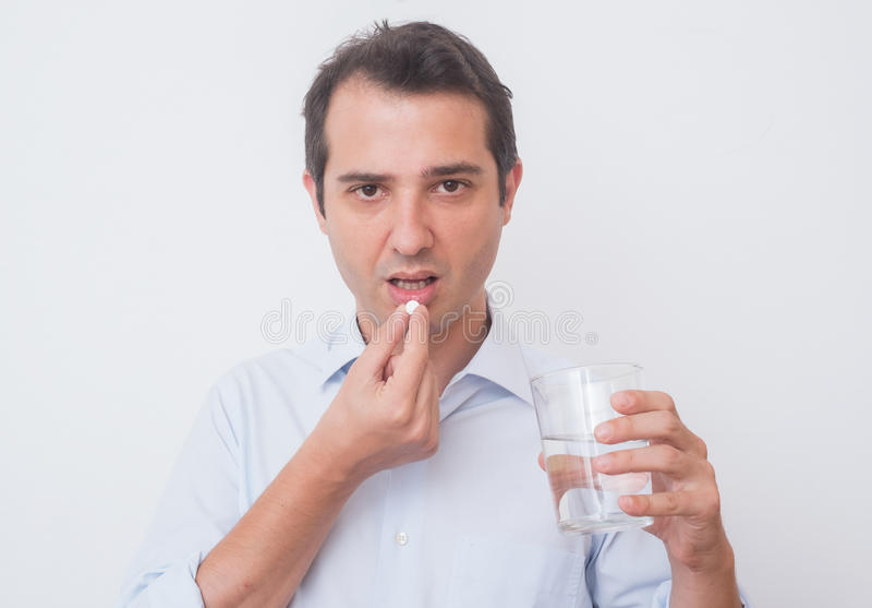 Medicamentação antropófaga doente do comprimido de aspirin imagens de stock
