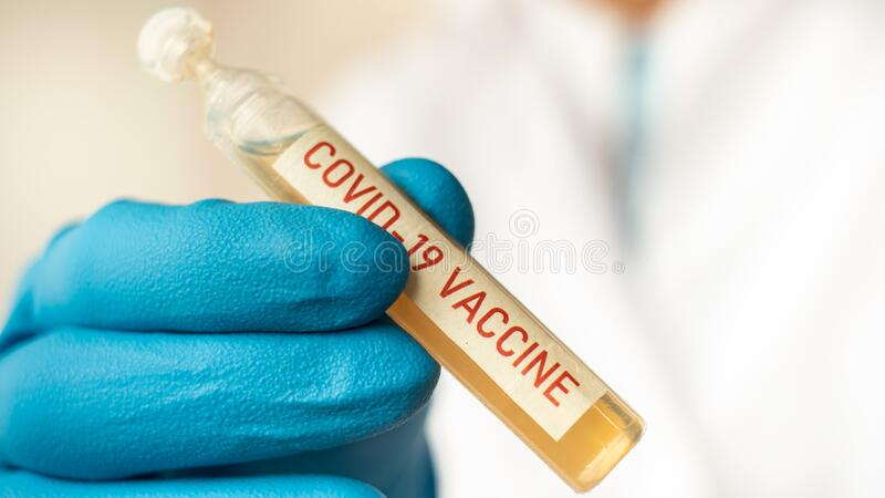 Medicamento o tubo de retención de laboratorio con vacuna nCoV Coronavirus COVID imágenes de archivo libres de regalías