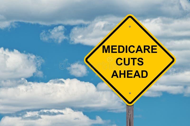 Medicare οι περικοπές προειδοποιούν μπροστά το σημάδι στοκ φωτογραφία με δικαίωμα ελεύθερης χρήσης