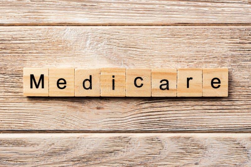 Medicare-Wort geschrieben auf hölzernen Block Medicare-Text auf Tabelle, Konzept stockfoto