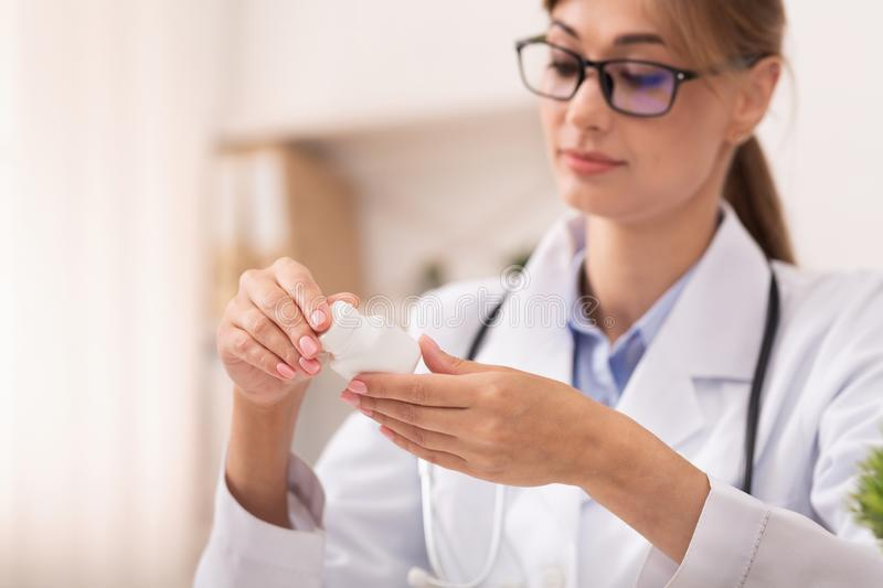 Doctor Woman Prescribing Pharmacological Treatment Sitting In Office royalty free stock photos