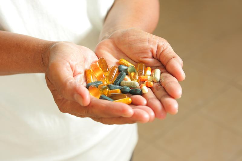 Medication is in the hands of an elderly woman. royalty free stock photography