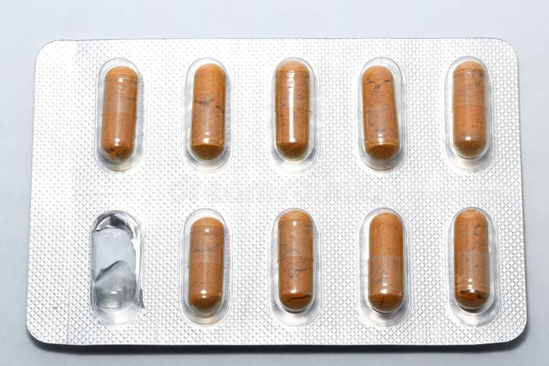 Medication pill. Pill on buster pack . Concept for start of medication after taking the 1st pill stock photography