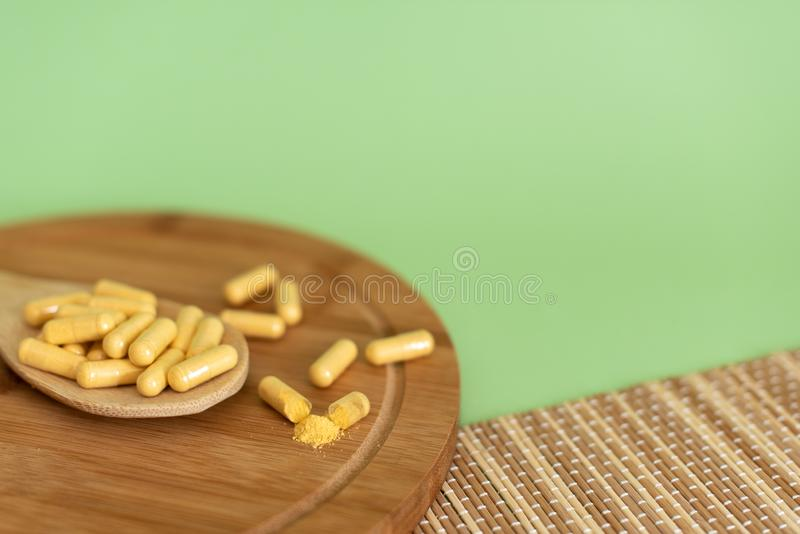 Medication pills in bulk on a monophonic background. Pharmaceutics concept. Drug in hospital royalty free stock image