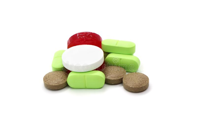 Medication pills are a bunch of multi-colored objects isolated on a white. Medication pills are a bunch of multi-colored objects isolated on a white background stock photography