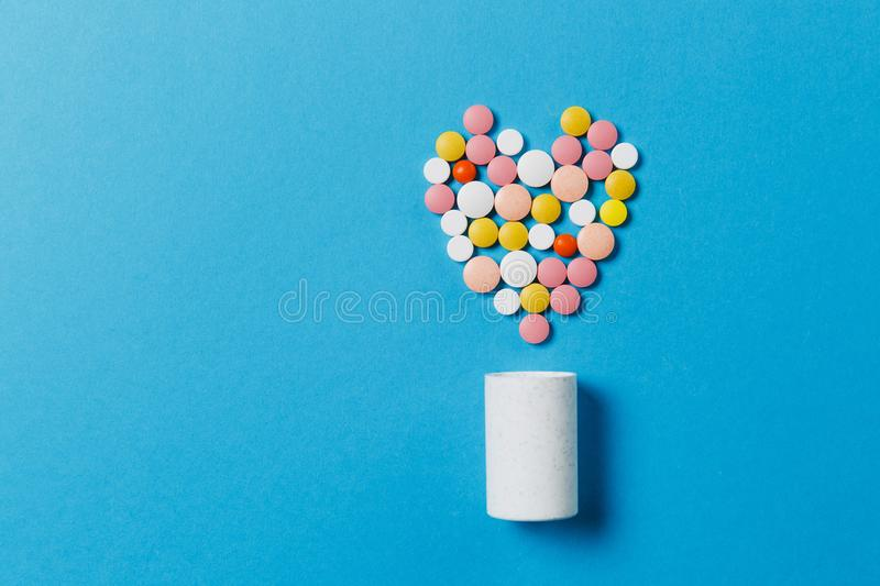 Medication tablets on color background. Concept of health, treatment, choice, healthy lifestyle. stock image