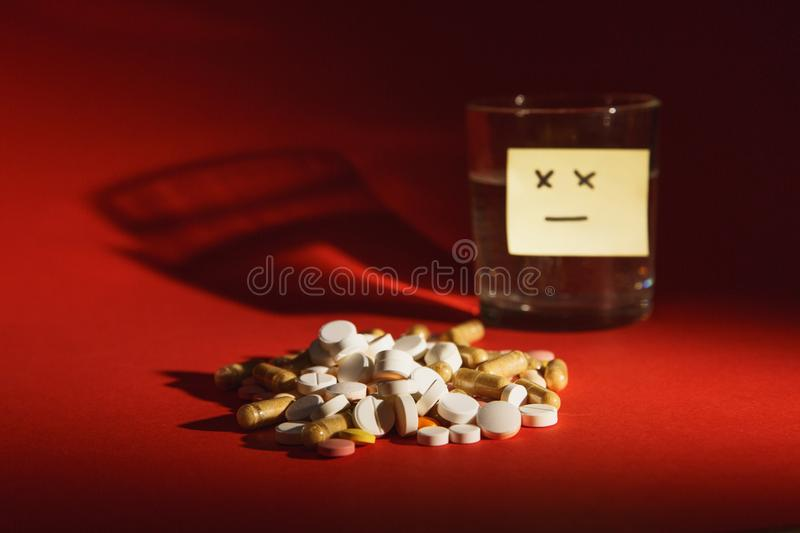 Medication tablets on color background. Concept of health, treatment, choice, healthy lifestyle. royalty free stock images