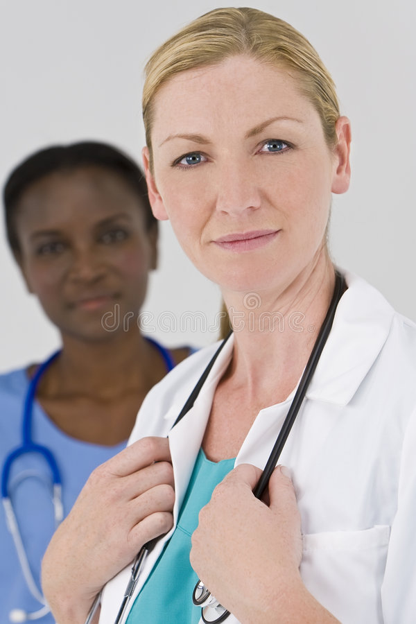 Medici femminili felici immagine stock
