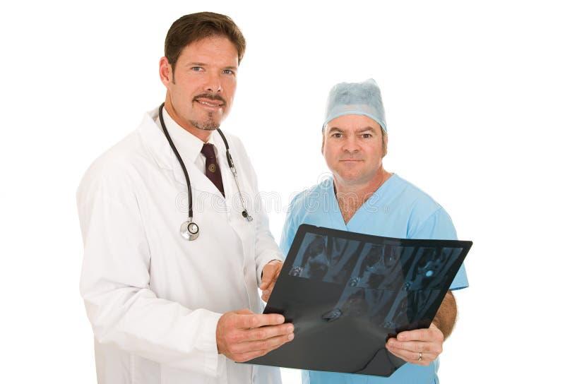 Medici in maniera fidata immagini stock