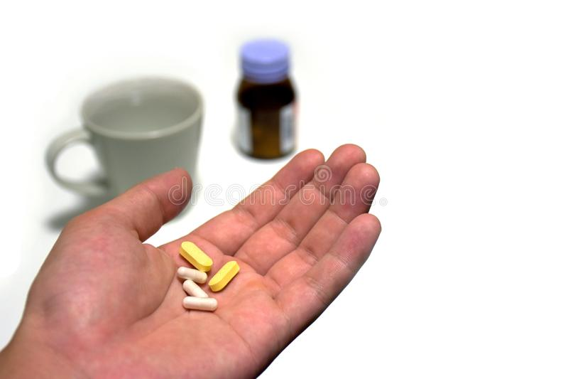 Medicina de las píldoras y de las cápsulas de la medicina a disposición imagen de archivo