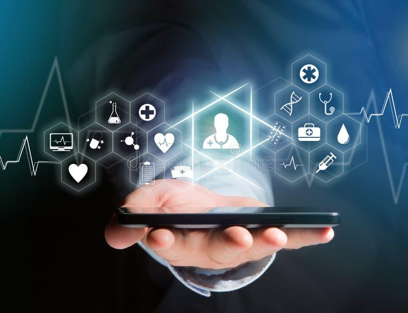 Medicina e icono general de la atención sanitaria exhibidos en una tecnología i fotografía de archivo libre de regalías