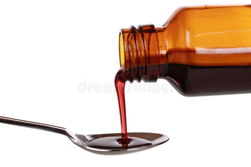 Medicina líquida em uma garrafa imagens de stock royalty free