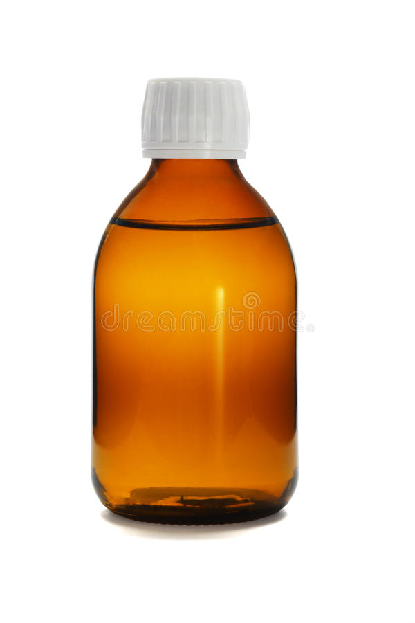 Medicina líquida en la botella de cristal fotos de archivo