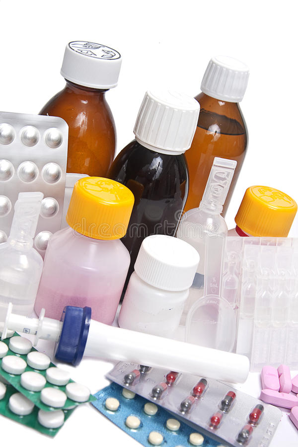 Medicinal bottles and tablets royalty free stock photography