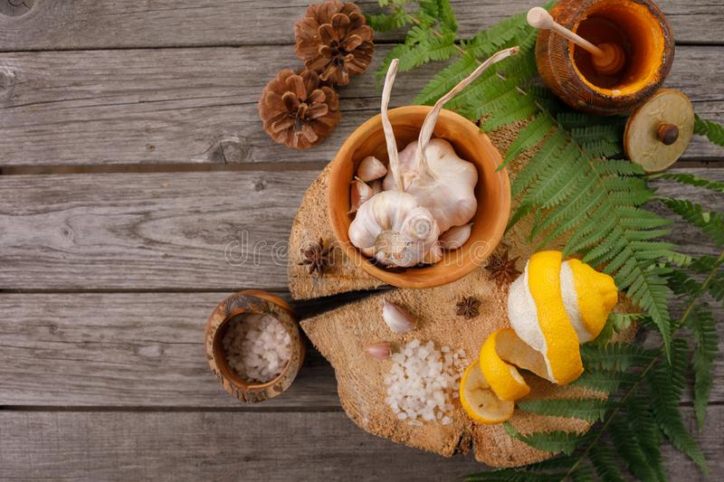 Medicinal ingredients. Ethnoscience. Background with leaves of fern, honey and lemon. Vintage on aged wood with copy space. Layout. For seasonal special offers royalty free stock image
