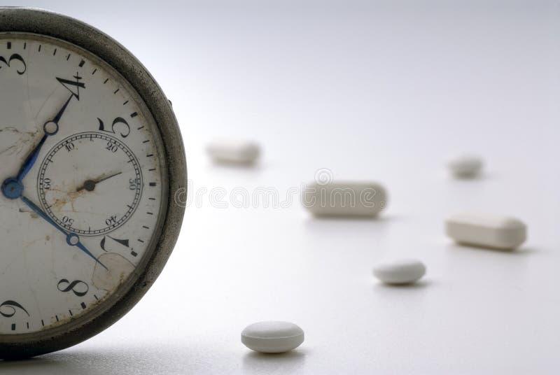 Medicinas por a hora fotos de stock