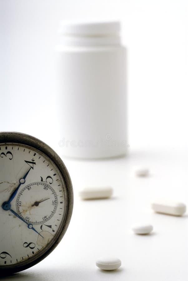 Medicinas por hora imagenes de archivo