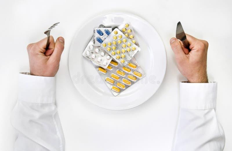 Medicinas y píldoras para la cena. foto de archivo