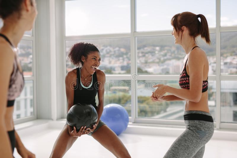 Medicine ball group exercise at gym stock image