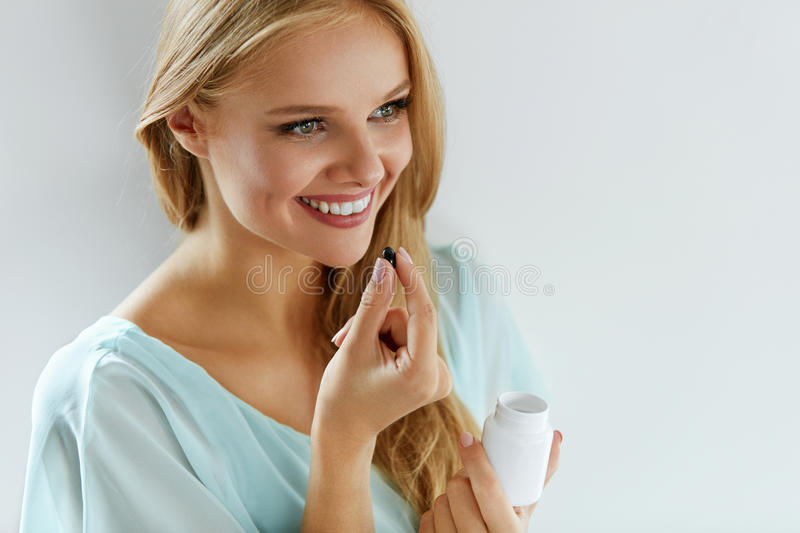 Medicine. Beautiful Girl Taking Medication, Vitamins, Pills. stock photo