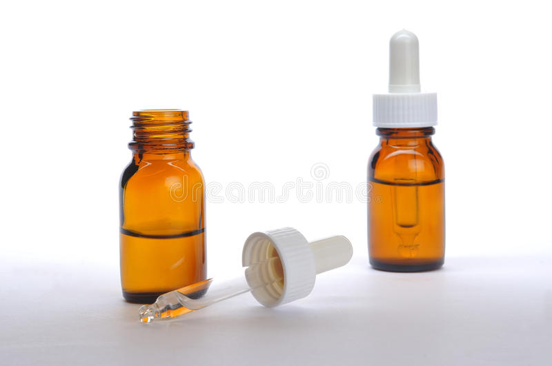 Medicine bottle. Liquid medicine in bottle on white background stock images