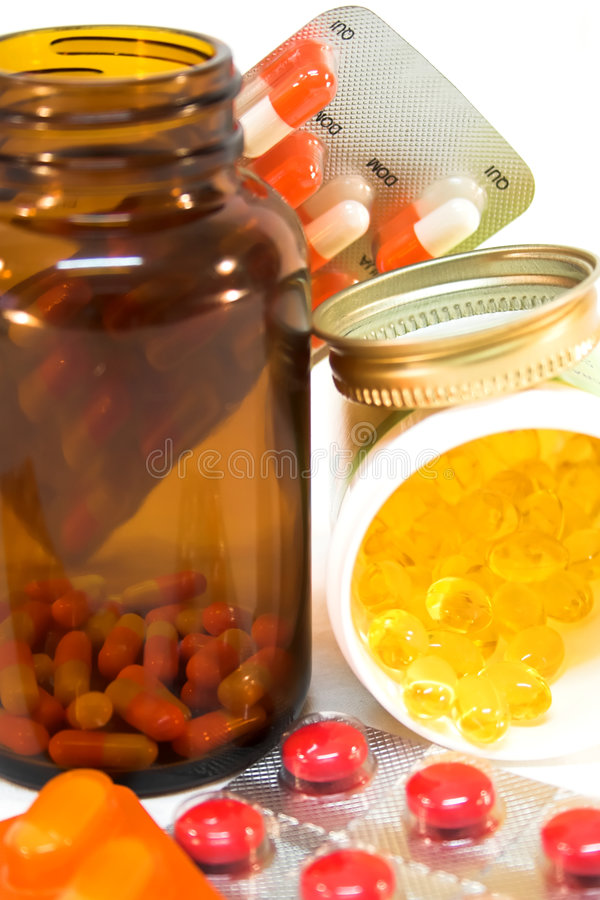 Medicine bottles with pills stock photography