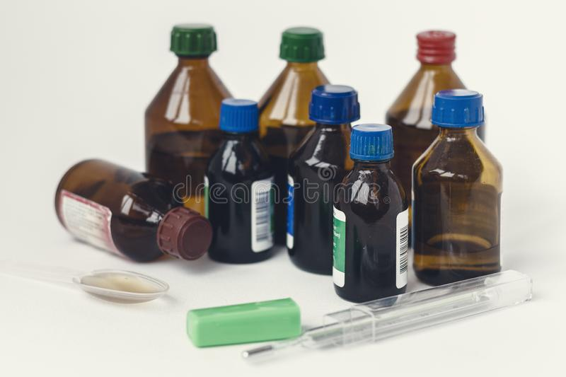 Medicine bottles on white background with copy space for text, retro concept closeup royalty free stock images