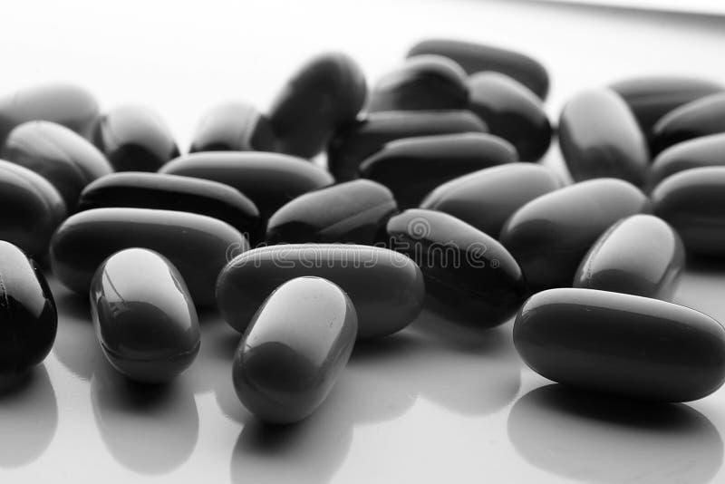 Medicine BW. Capsules isolated on white stock photography