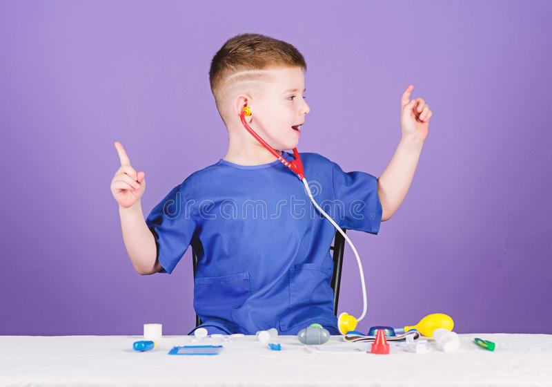 Medicine concept. Health care. Medical examination. Medical education. Play game. Boy cute child future doctor career. Healthy life. Kid little doctor sit royalty free stock photo