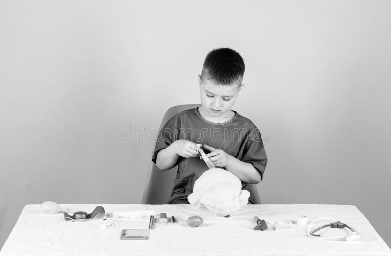 Medicine concept. Medical procedures for teddy bear. Medical examination. Medical education. Boy cute child future. Doctor career. Health care. Kid little stock image