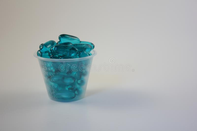 Blue Capsules in a Cup royalty free stock images