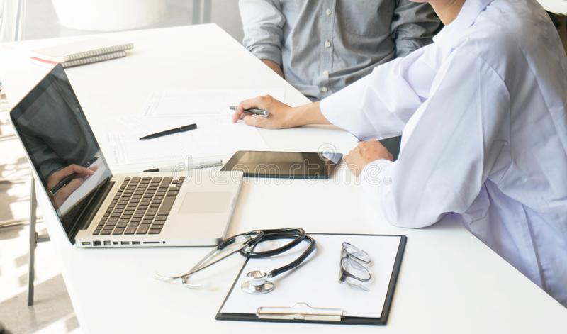 Medicine doctor explain diagnosis to doctor team holding and showing clipboard exploring important document. Medicine doctor explain diagnosis to doctor team royalty free stock images