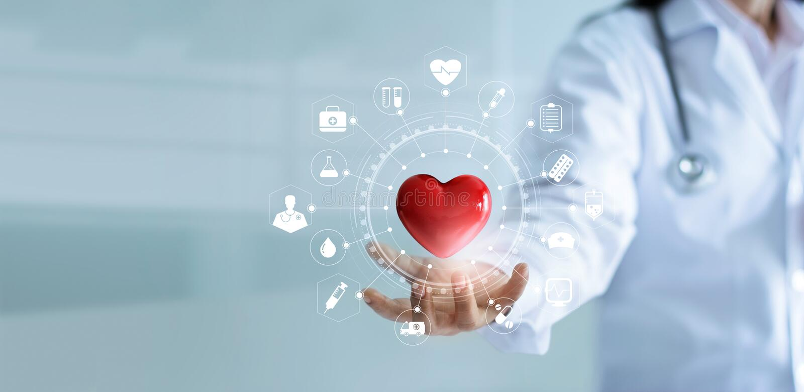 Medicine doctor holding red heart shape with medical icon network. Medicine doctor holding red heart shape in hand with medical icon network connection modern stock photo
