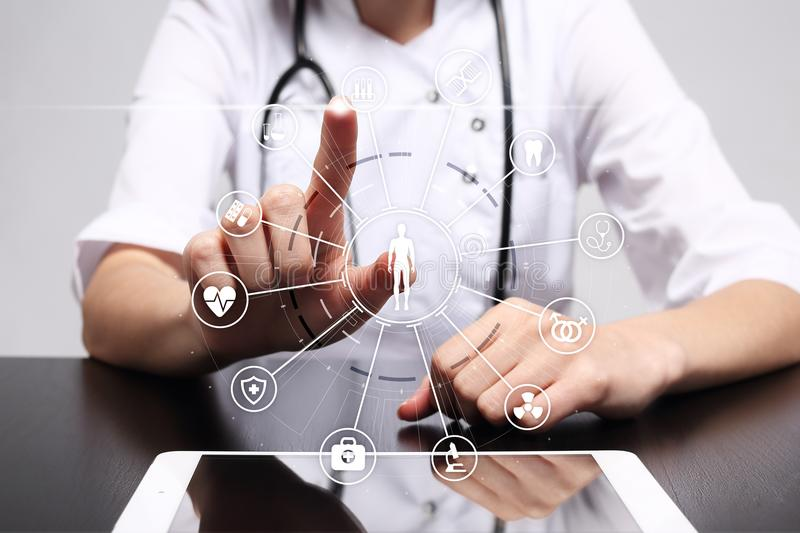 Medicine doctor with modern computer, virtual screen interface and icon medical network connection. Medical concept. Medicine doctor with modern computer stock images