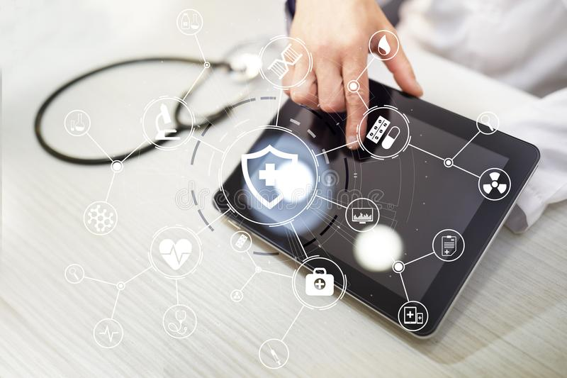 Medicine doctor with modern computer, virtual screen interface and icon medical network connection. medical technology. Network and health care concept royalty free stock photos