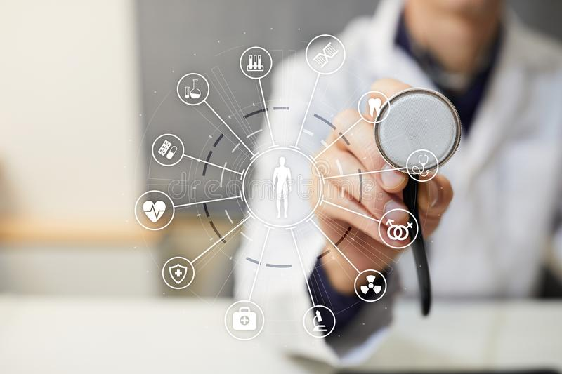 Medicine doctor with modern computer, virtual screen interface and icon medical network connection. Medical technology. Network and health care concept stock photography