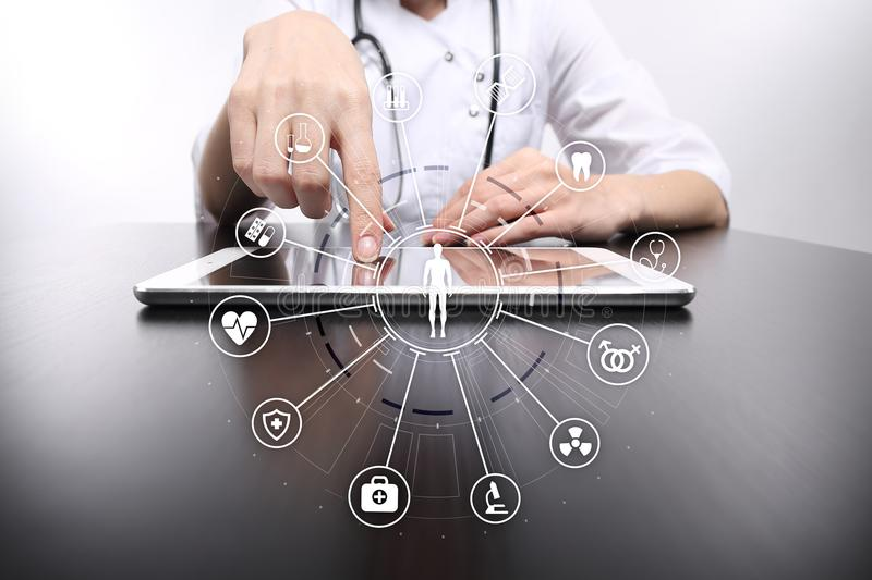 Medicine doctor with modern computer, virtual screen interface and icon medical network connection. Medical technology network and health care concept royalty free stock image