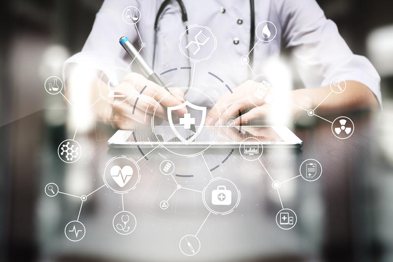 Medicine doctor with modern computer, virtual screen interface and icon medical network connection. Medical technology network and health care concept stock image